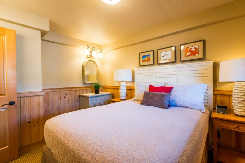 Beautiful bed set up in our Oceanfront Queen Suite with Sofa Sleeper